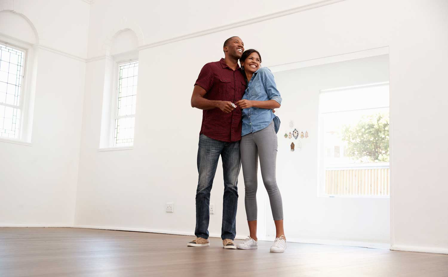 Excited young couple approved for a mortgage and moving into their new home