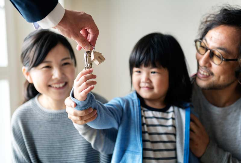 New immigrant family buying their new home in Canada