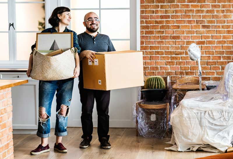 Self-employed couple moving into their new house because they were approved for a mortgage