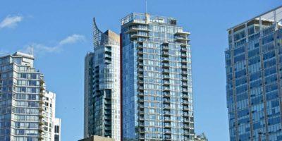 Condominiums against a clear blue sky