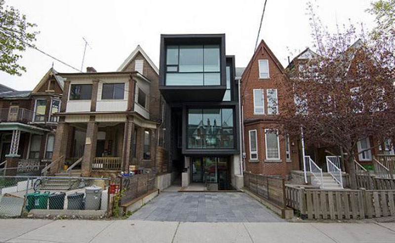 A modern-style home in between two traditional Toronto houses