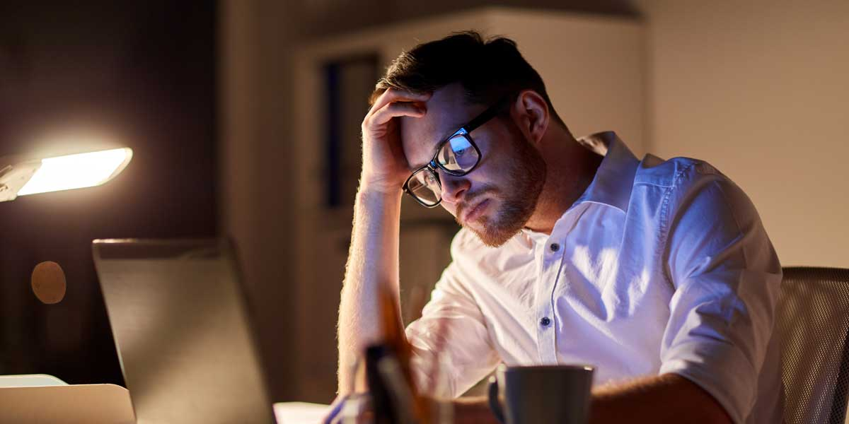 Stressed mortgage broker waiting on an alternative lender to close a deal